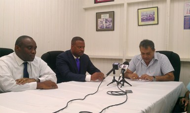 GPHC Chief Executive Officer Michael Khan (right) responds to question from the media yesterday with St. Kitts and Nevis Health Minister Mark Brantley (centre) and John Essien, Medical Chief of Staff, Alexandra Hospital Nevis.