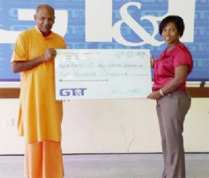 In this GT&T photo, GT&T's Nicola Duggan makes the presentation to the swami.