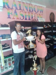 Organiser Richard receiving the winner's trophy from Shellon August of Rainbow Fashion