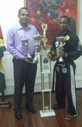 Martial Arts Hall of Famer Roland Eudoxie posing with Minister of Culture, Youth and Sports Dr. Frank Anthony.