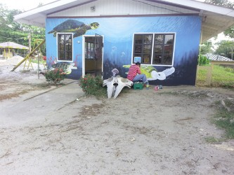 Repainting of murals on the Nature School building
