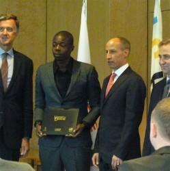 Idi Lewis proudly displays his ICECP certificate.