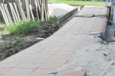 This section of a walkway was also damaged by ongoing work to the 25-metre pool