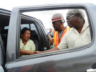 General Manager of the DHB Rawlston Adams and Minister Robeson Benn meeting Roopchand's wife after the accident. (Photo by Aneka Edwards/Ministry of Public Works)