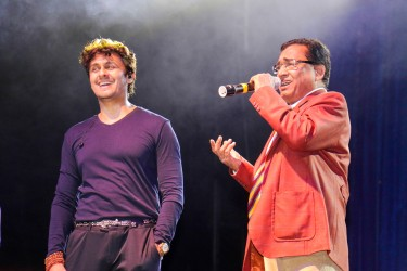 Father and son: Sonu Nigam (left) and his father Agam Kumar Nigam on stage at the Nigam 'Klose to my Soul Concert' last night at the National Stadium, Providence. (Photo by Arian Browne)