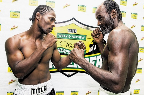 Kevin 'Bus Boy' Hylton (left) of Team Jamaica stares down his opponent Howard 'Batter Tea' Eastman of Team Caribbean ahead of today's fight.