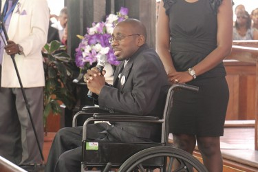 A friend paying homage to Lawrence Williams at his funeral service on Saturday at the St George's Cathedral.