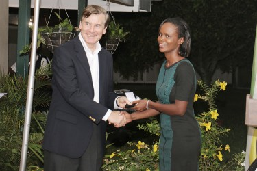 Stabroek News senior reporter Oluatoyin Alleyne receiving a token of recognition for her reporting on trafficking in persons from US Ambassador Brent Hardt on Friday at a reception he hosted in commemoration of World Press Freedom Day.