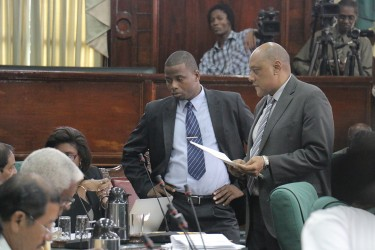 Speaker of the National Assembly Raphael Trotman (right) speaking to AFC MPs yesterday in the National Assembly.