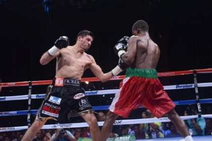 Atwell (right) during the fight (WBC photo)