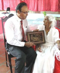 Sogaree Jattan, pictured in 2008, receiving the Citizens for a Better Trinidad and Tobago's Republic Day award in 2008, from his president Harrack Balramsingh, who also died recently.