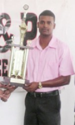 Khemraj Pooranmall after winning last year's P&P 100 sqaures tournament.