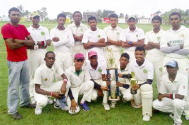 The winning West Demerara side with manager Sudesh Persaud standing to the far left.