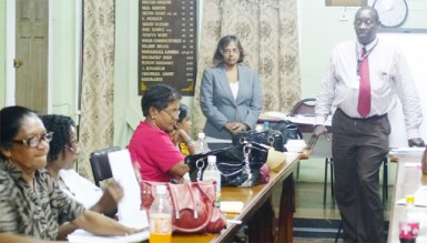 Aggrey Azore and Indra Ramcharran of the Human Services ministry speaking to participants