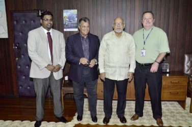 President Donald Ramotar (third from left) with (from left) Minister of Tourism (ag) Irfaan Ali, Roraima Airways CEO Capt. Gerry Gouveia and Senior Vice President Business Operations Dynamic Airways Tom Johnson. (GINA photo)