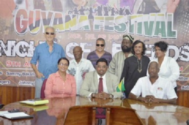 Minister of Tourism, Industry and Commerce (ag) Irfaan Ali (sitting at centre), Lennox Canterbury (sitting at right), Coordinator of the Night of the Legends and Tameca Sukdeo-Singh (sitting at left) and some of the artistes to perform at Night of Legends at the Guyana Festival. (GINA photo)
