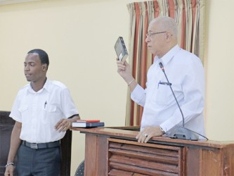 Key witness, former Guyana Defence Force Chief of Staff Norman McLean taking the oath during yesterday's proceedings.