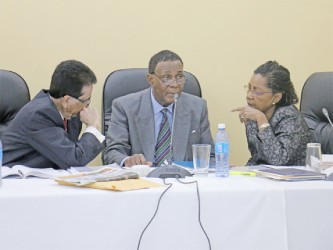 Chairman of the Commission Sir Richard Cheltenham (centre) in dialogue with his fellow commissioners Seenath Jairam (left) and Jacqueline Samuels-Brown during yesterday's proceedings.