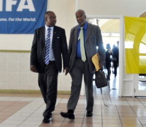 U-turn! Odinga Lumumba, right says he is willing to work along with GFF president Christopher Matthias following FIFA's ruling of a few days ago.