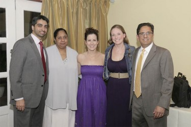 Dr. Rajiv Jauhar (right) stands with his team from the Long Island Jewish Hospital at Cara Lodge on Friday.