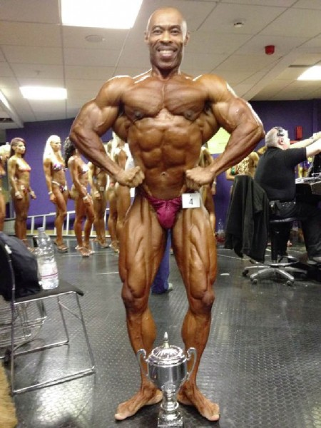 Hugh Ross posing with his second place trophy at the 31st NABBA World Bodybuilding Championships Saturday at the Belfast Waterfront in Northern Ireland.