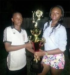 Future's skipper Keron Solomon receiving the winning trophy from August Beverage sale representative Annastatia Lewis.