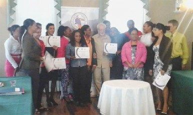 Participants pose with President of THAG Kit Nascimento and facilitators