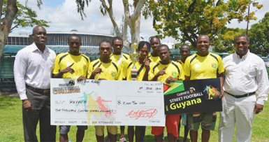 The Guyana team with Lee Baptiste, Guinness Brand Manager, Mortimer Stewart, Outdoor Events Manager of Banks DIH and Referee Wayne Griffith.