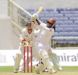Guyana's Shivnarine Chanderpaul pulls for four on the way to recording his 63rd test half century yesterday. (Photo courtesy of WICB media)