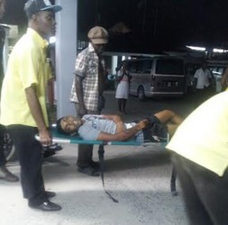 The unidentified man as he was being rushed into the hospital last night.