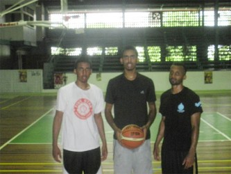 Damian Persaud (left), Tyler Persaud (centre) and Richard Hall at the Cliff Anderson Sports Hall