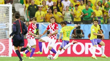 Neymar of Brazil shoots and scores against Dejan Lovren of Croatia in the first half during the 2014 FIFA World Cup Brazil Group A match between Brazil and Croatia at Arena de Sao Paulo yesterday in Sao Paulo, Brazil. (Photo by Adam Pretty/Getty Images)