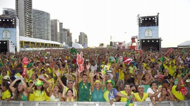 Brazil fans celebrate the first goal scored by Neymar at the FIFA Fan Fest on June 12, 2014 in Fortaleza, Brazil. (Photo by Laurence Griffiths/Getty Images)