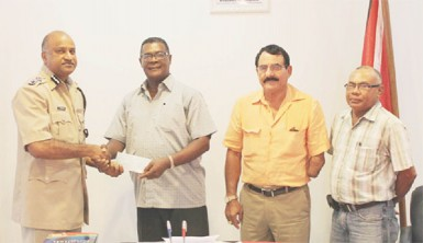 Making the presentation to acting Police Commissioner Seelall Persaud (left) on behalf of the GGDMA was the President of the Association, Patrick Harding (second from left) who was accompanied by Vice-President Charles Da Silva (third from left) and Executive Member Dabria Marcus. (Guyana Police Force photo)