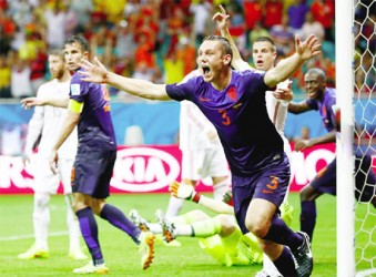 Stefan de Vrij of the Netherlands scores against Spain during their 2014 World Cup Group B match at the Fonte Nova arena in Salvador yesterday. REUTERS/Fabrizio Bensch