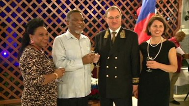 From left are Yvonne Hinds, Prime Minister Samuel Hinds, Russian Ambassador Nikolay Smirnov and his wife Tatiana Styablina toast at the Russia Day celebration. (GINA photo)