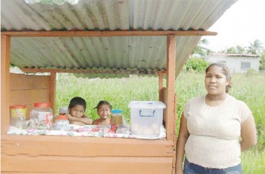 Street vendor, Althea Goocharan and her two children