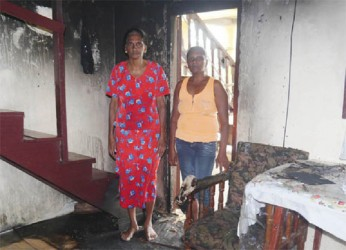 Seeta Persaud and her mother, Pulmattie in their badly gutted kitchen