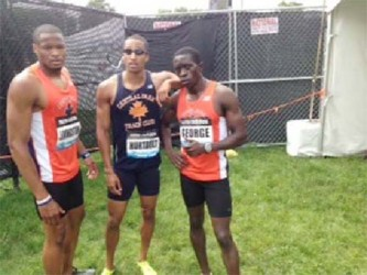 Winston George (right) poses with his club teamates after his record 400m run in New York Yesterday.
