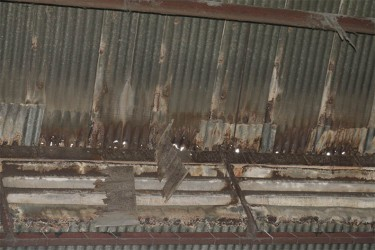 Part of the ceiling at La Penitence market is on the verge of falling off