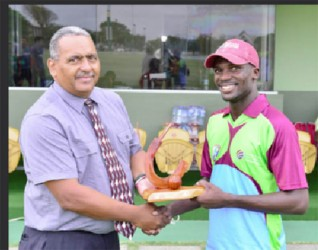 Match referee Colin Bowen presents the Man of the Match award to Jonathan Carter. (Photo courtesy of WICB media)