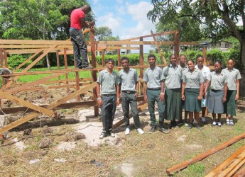 Students of the Diamond Special Needs School on the East Bank Demerara posing in front of the first shade house currently being built as a part of a hydroponic project in collaboration with Partners of the Americas. (Photo courtesy of Deaf Guyana)