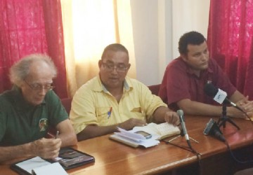 President of the GRFU, Peter Green makes a point at yesterday's press briefing as Vice President, Mike McCormack (left) and Treasurer of the union, Roger Perreira look on.