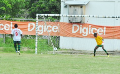 Quincy Lawrence of St. George's High dispatching the winning penalty kick to seal the win for his team over Dolphin Secondary