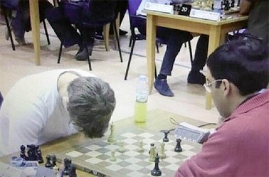 Seriously making a statement? World champion Magnus Carlsen bows his head in dejection as he blunders and loses a game to Vishy Anand at the World Rapid championship in Dubai, United Arab Emirates.  Carlsen, however, emerged victorious in the championship tournament scoring a half point more than the competition. For his effort in the two day tournament, Carlsen carted off US$40, 000. He is scheduled to face Anand in November for the world championship chess title.