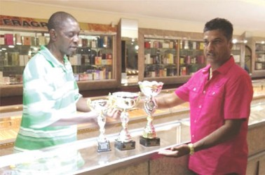 In the picture above, Corporal Linden Matthews, left receives the trophies from Steve Narine proprietor of Steve's Jewellery.