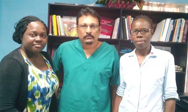 Dr. Jeetendra Mohanlall (centre) stands with two members of his TB team. TB DOTS Prison Supervisor Gerilyn Mc Kenzie (left) and Dr. Phenila Rogers.