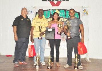 The overall winners of yesterday's championship Winston Stoby, Chloe Hunter and Roger Callendar, pose with president of the GAPF, Peter Green. (Orlando Charles photo)