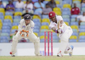 West Indies opening batsman Kraigg Brathwaite gathers runs on the leg side on the way to his fifth Test half century. (Photo courtesy of WICB media)