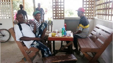 A few friends sharing a drink at the popular hangout spot, '110 Koker'